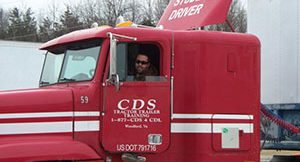 student driving a red cds training truck