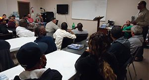 large group of students listening to instructor in classroom