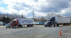 two cds trucks parked in the yard