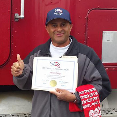 cds grad posing with his certificate