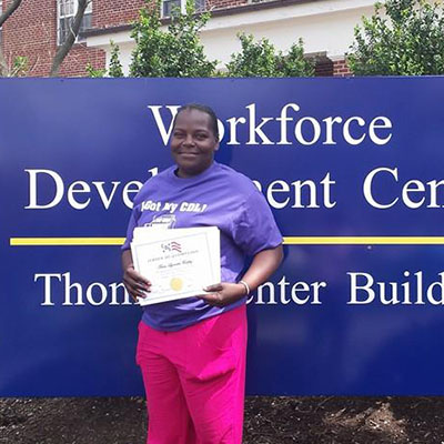 cds grad posing with her certificate