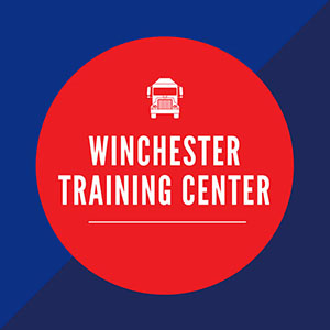 blue box with red circle in middle saying Winchester Training Center