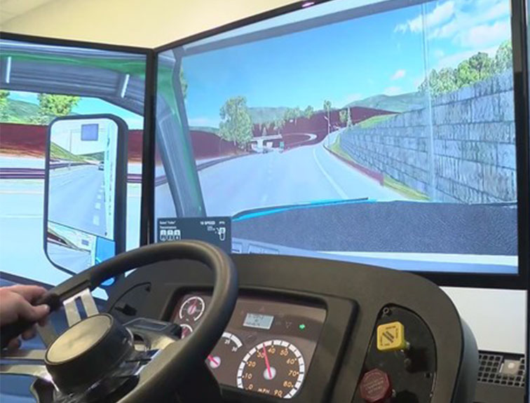 student sitting at trucking simulator driving