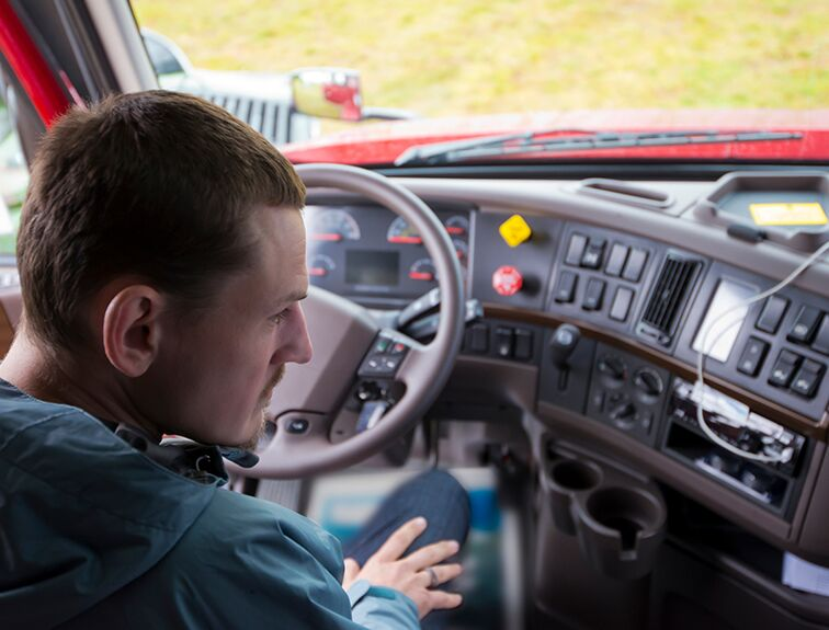 student sitting in truck cab looking at dials