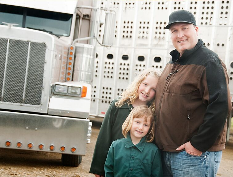 trucking dad with 2 daughters smiling